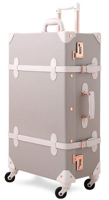 valise a roulette au look classe et vintage grise et blanche