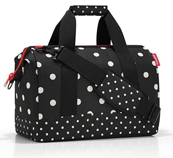 petit sac de voyage feminin Reisenthel Allrounder taille M noir avec des gros points blancs